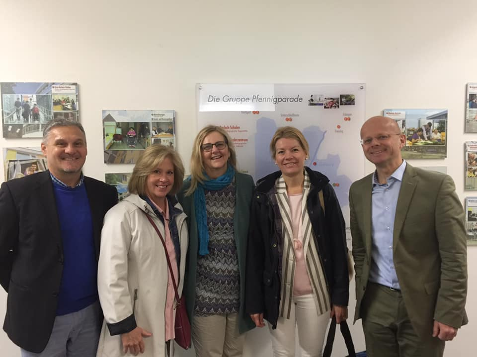 Group picutre of 5 showing Patti Herbst, Acena, ECA and Mr. von Moreau of Stiftung Pfennigparade smiling.