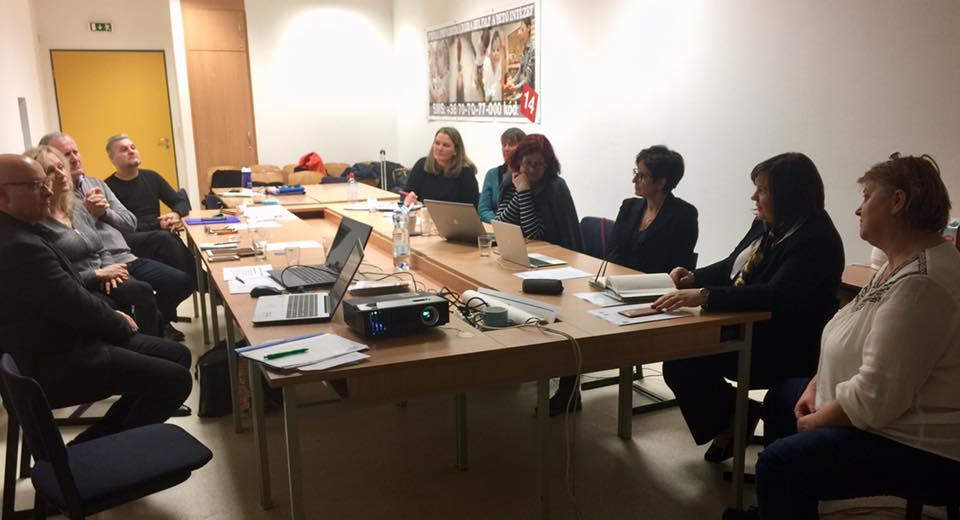 ECA Board meeting in Hungary. All board members sitting around table at meeting.